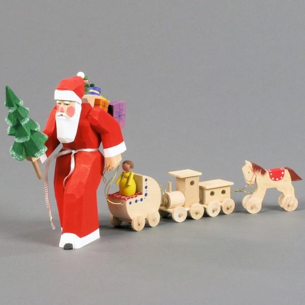 Dregeno Erzgebirge - Schnitzerei - Weihnachtsmann mit Spielzeugzug - 16,5cm