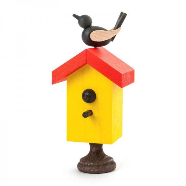 Dregeno Erzgebirge - Miniatur-Starhaus mit Singvogel, farbig