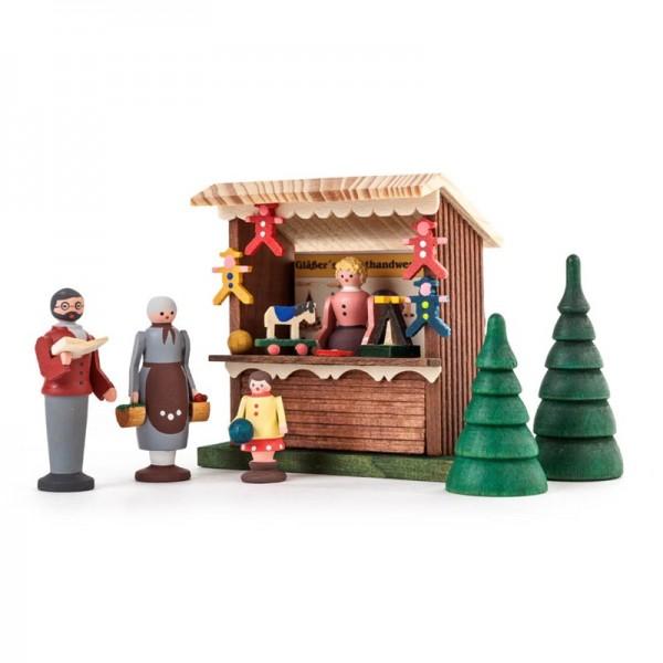 Dregeno Erzgebirge - Miniatur-Spielwarenbude mit 3 Figuren und 2 Bäumchen